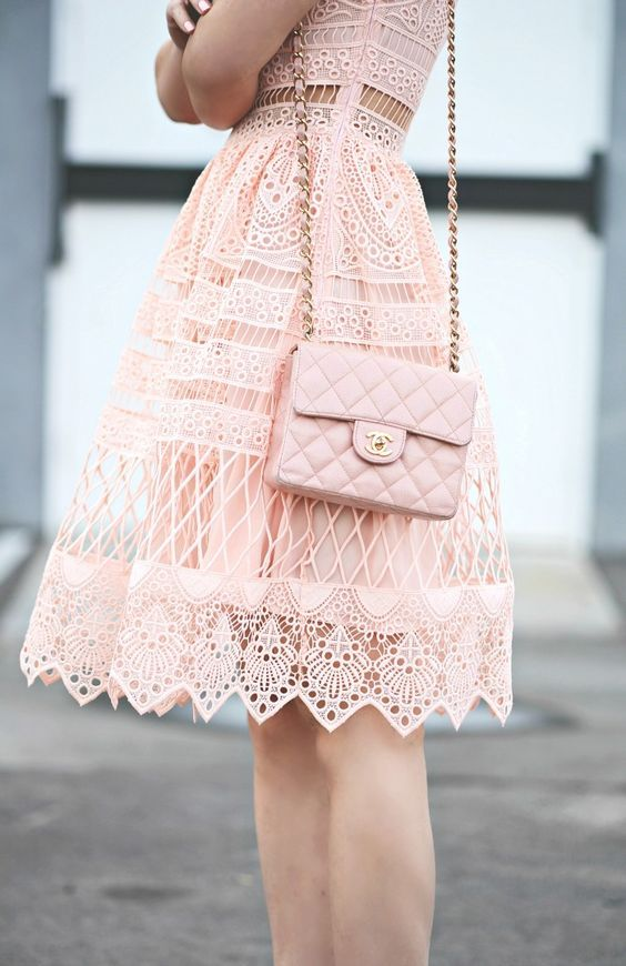 pink lace fress and a chanel pink bag