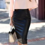 soft pink top with a black pencil skirt business